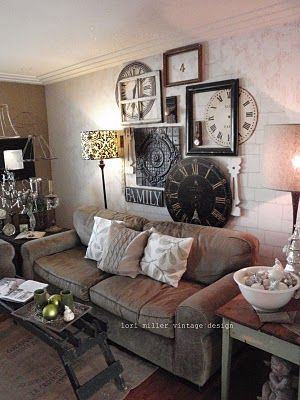 Shabby Living Room...wall of clocks & old frames...comfy sofa, textured walls, rug, & soft pillows...Now I know what to do with my bedroom clock
