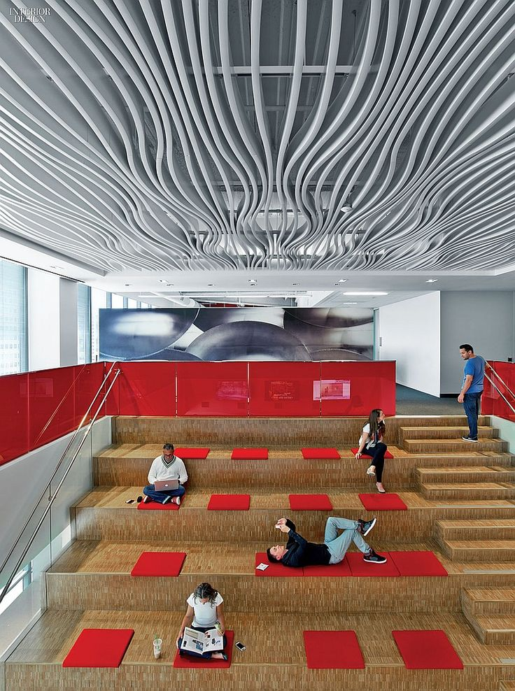 Avery Dennison HQ Office. Baffles in enameled aluminum undulate above an amphitheater built from plywood. #office