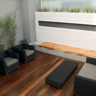 Modern Urban Rooftop Patio, love the black furniture and white wall