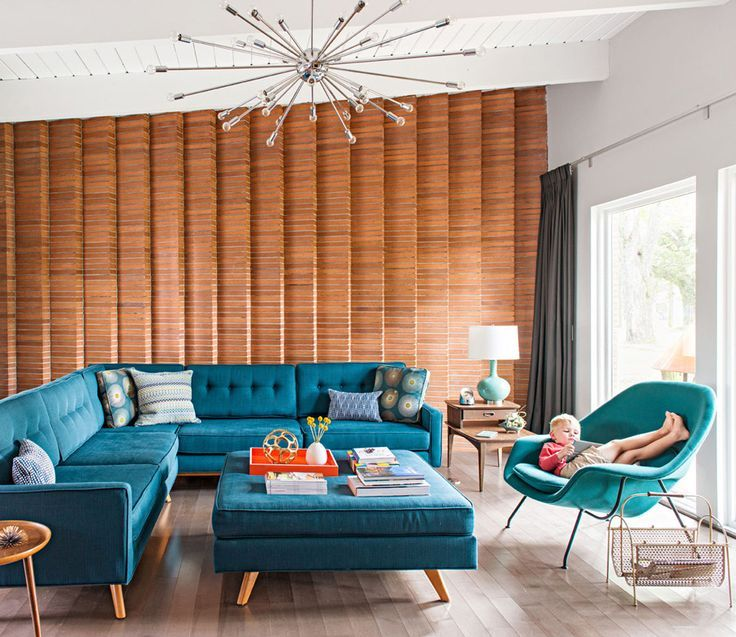 A wall in this Michigan home from the late 1950s reflects the stone and brick flourishes that often mark midcentury design. Gorgeous mid century living room with teal and turquoise furniture.