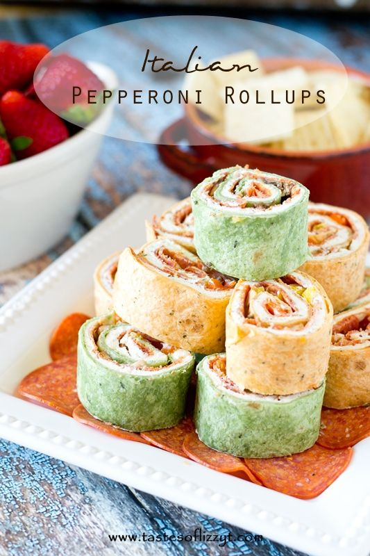Italian Pepperoni Rollups >> by Tastes of Lizzy T's. Your favorite pizza toppings alongside garlic cream cheese all rolled up in a tortilla. These Italian Pepperoni Rollups are the ideal lunch, appetizer or snack for pizza lovers everywhere.