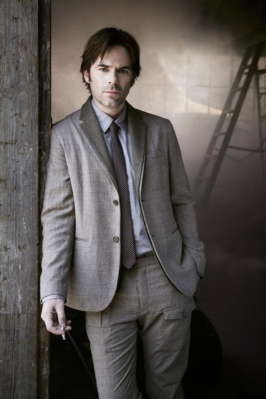 A suited Billy Burke