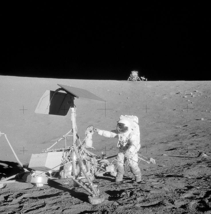 Apollo 12 - Pete Conrad standing next to Surveyor III and the LM far in the background [2340x2370]