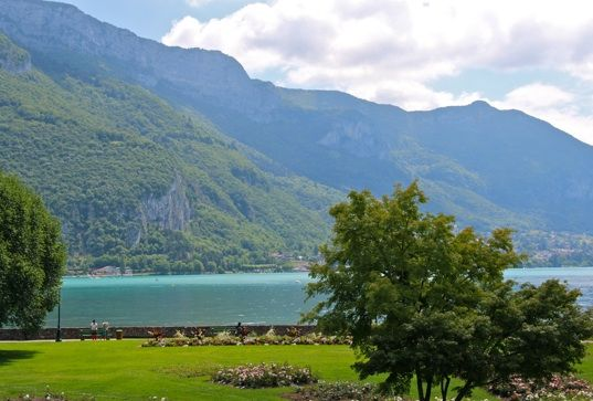View of Lake Annecy from the park-like grounds of L'Imperial Palace Annecy Hotel. #France