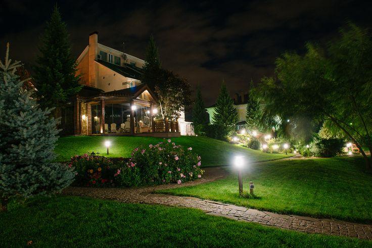 Garden path lights and a garden socket. Lighting design by Belisama Lighting and the lighting designer Kamil Akhmedov.