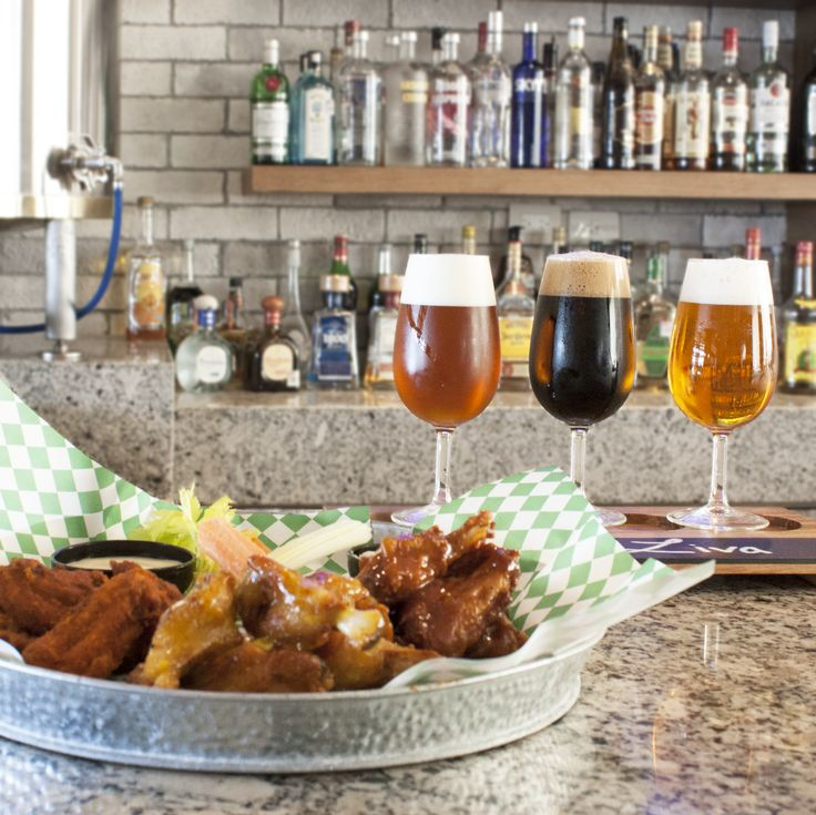 Try all 10 flavors of wings at Tres CerveZas