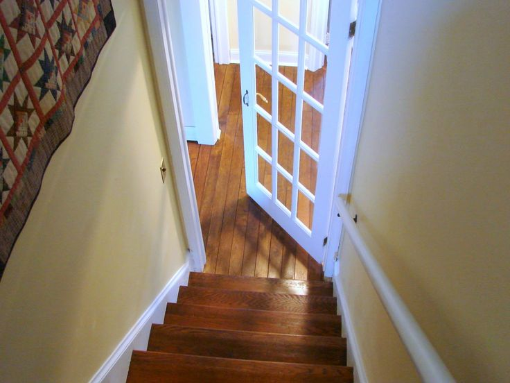 I love this door at the bottom of the stairs...it is EXACTLY what I want leading into the basement.