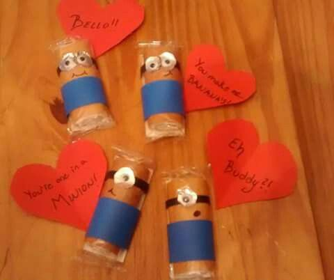 Minion Valentine's I used Little Debbie Strawberry Shortcake Rolls instead of Twinkies. Plus black, red, dark blue construction paper, tin foil, googly eyes and tape. Easy!!!