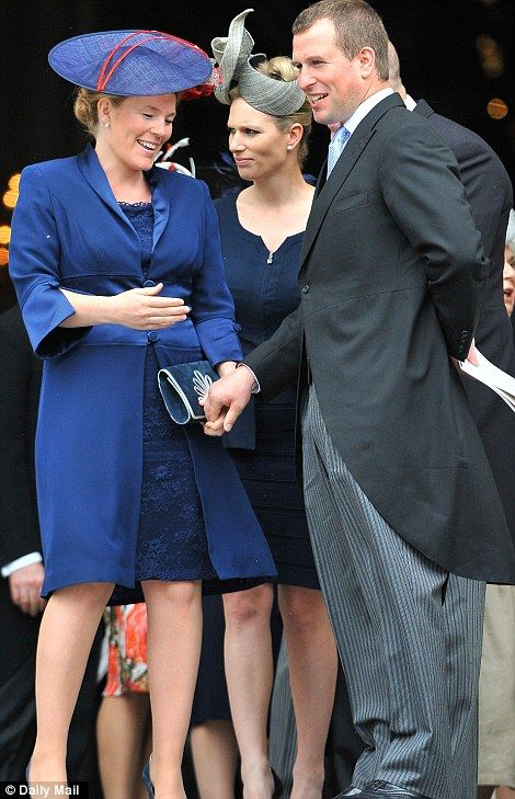 Autumn Phillips's midnight blue lace dress and matching silk-trimmed coat was topped off with a patriotic touch - a blue sinemay disc hat with a red flourish