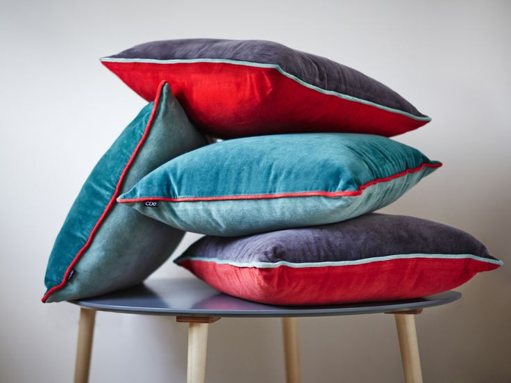 Give your home an eclectic touch with Carolyn Donnelly's vibrant cushions in shades of red and blue