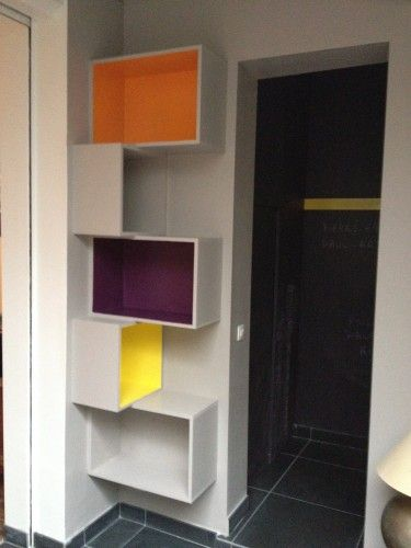 Could put these in the corner opposite the wall with the couch. I love the idea of different colors especially since it is also the kids play room. Cat shelves boxes #cats #CatShelves Could also make with wood crates