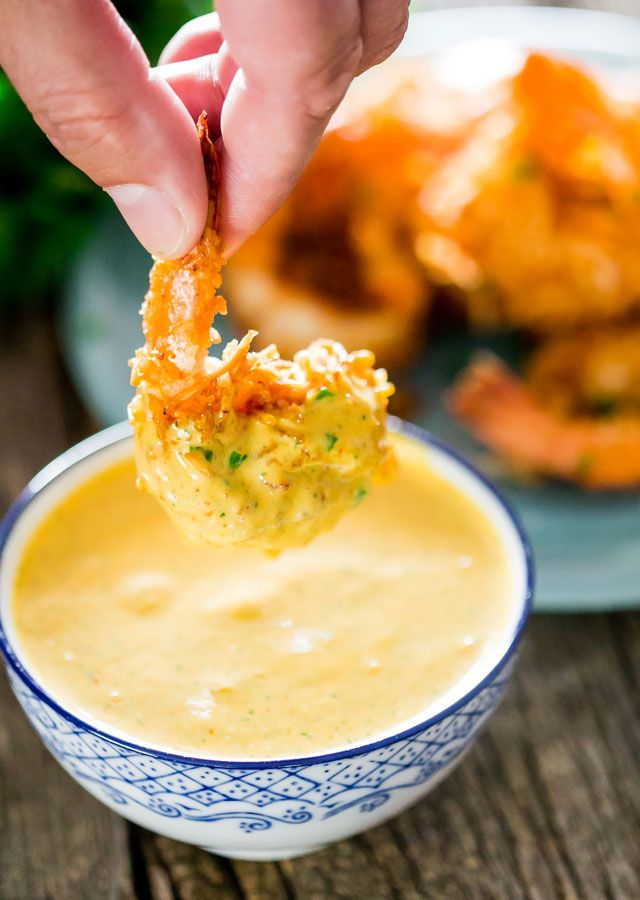 Coconut Shrimp with Spicy Mango Dipping Sauce - juicy jumbo shrimp rolled in sweetened shredded coconut, fried to a delicious crisp and served with an incredible spicy mango dipping sauce.