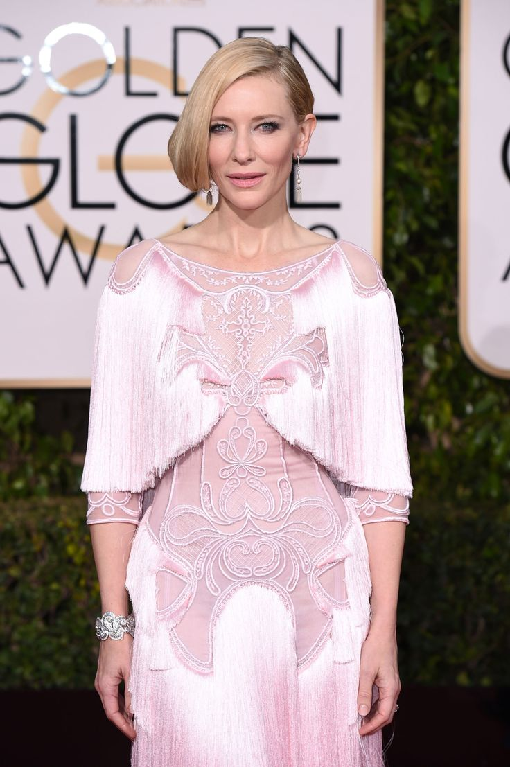 Cate Blanchett on the red carpet to the Golden Globes. The pink pastel, fringed Givenchy gown she wore was one of the night's most divisive dress choices, but no one could find fault in her delicate pearl, diamond and platinum earrings dating from 1915.