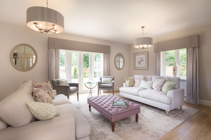 It's all in the detail; everything from the deep-buttoned furniture to the made to measure curtains and upholstered pelmets add to the feeling of luxury in this Cotswold home living room, whilst the soft accents of sage and lavender add colour and warmth to a soft rural scheme. You can find more examples of our work at http://www.janeclayton.co.uk/design-service/