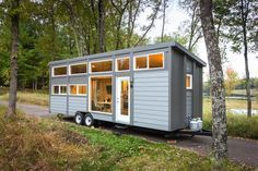 Premier tiny house house builders Escape have gone above and beyond their Traveler model, which already features major amenities like a full-size oven and bathtub, and have upsized to the Traveler ...