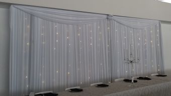 This bridal backdrop was done at the beautiful Cavalli Estate near Stellenbosch for a wedding coordinated by Trunk Events. Events draping can make all the difference, especially if it includes fairy lights.