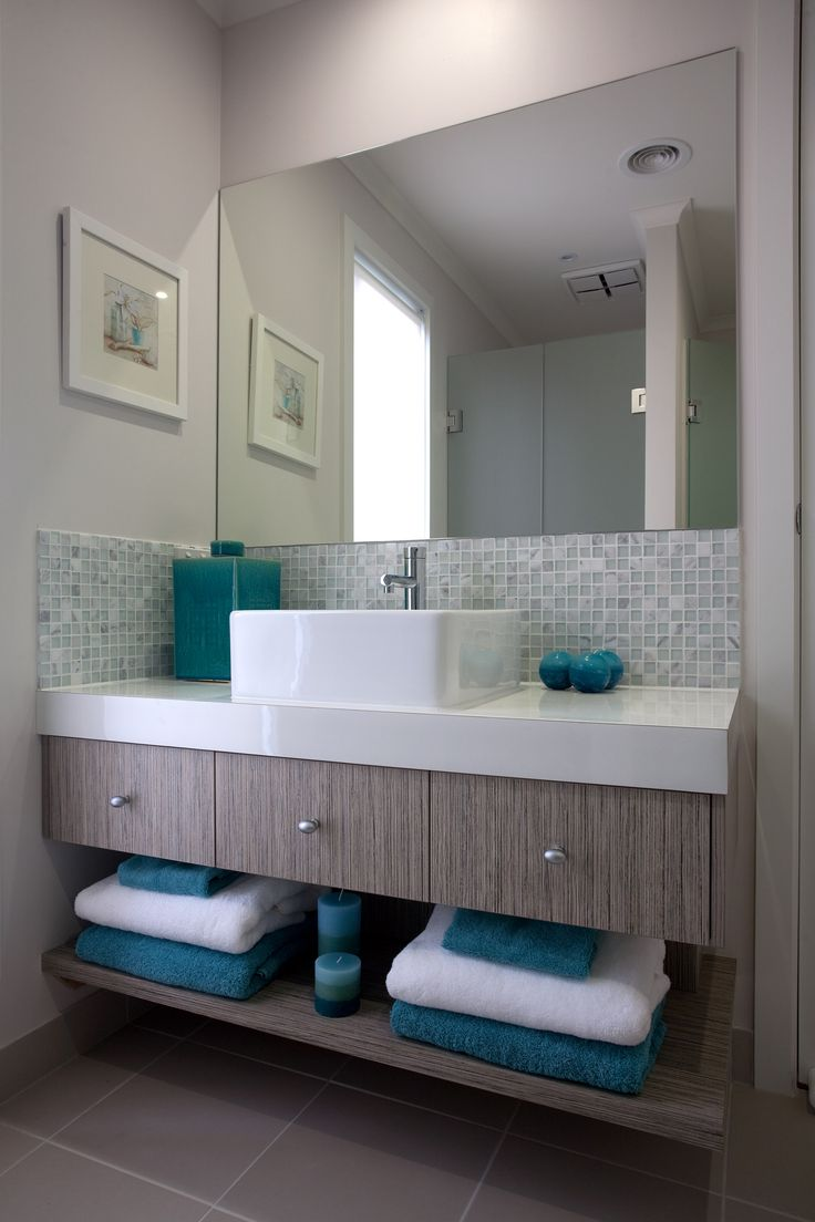 Add a touch of colour to your bathroom with your towels and accessories.