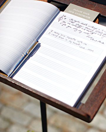 A guest book of sheet music perched on an antique music stand is a nod to the couple's musical careers