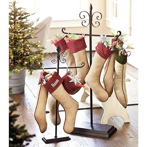 Don't have the traditional fireplace mantle to hang your stockings from? Try these stocking holders from Ballard Designs - the larger one is for the floor, the smaller for a tabletop!