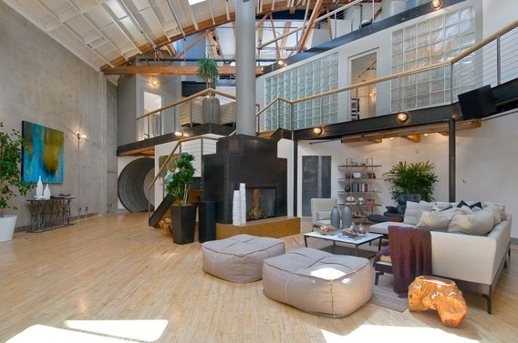 This 5,000 square foot beautiful and spacious loft home is located in SoMa, San Francisco. Converted from a former warehouse, this residential home boasts of multiple levels of mezzanines, with floors re-purposed from a Los Angeles airplane hangar and pay homage to that original hangar use reflected by nearly 30 foot exposed timber and white-washed ceilings.