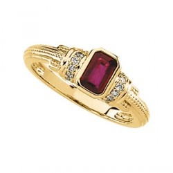 This quality genuine ruby gemstone ring with diamond accents in 14K yellow gold has limited availability.