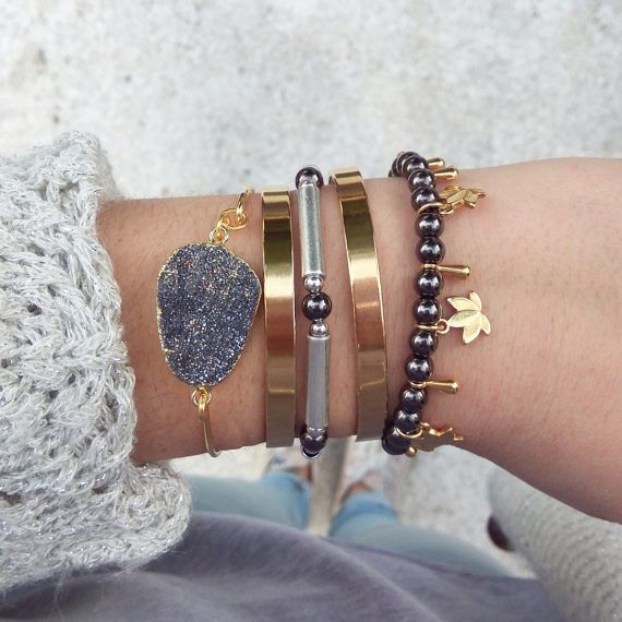 Boho Layered Bracelets This beautiful combo of bracelets will complete equally well your day and evening looks. Bangle bracelets made of silver and gold plated brass. 1. Gold bangle with silver agate druzy ( 24K Gold) 2. Gold plated cuff (24K Gold) 3. Silver & Gun metal bracelet 4. Gold plated cuff (24K Gold) 5. Lotus gold & gun metal beads 6. Combo of 5 bracelets 30% OFF!!!   Colors may vary slightly on your computer screen based on your settings.  *****    Payment methods available ...