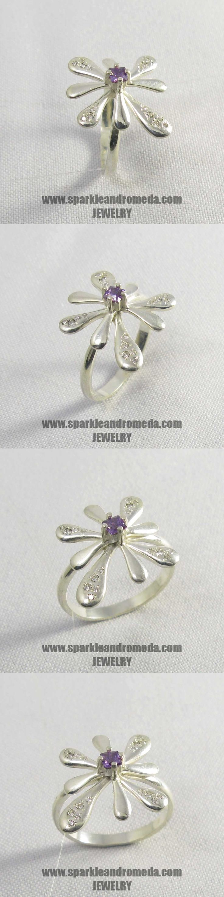 Sterling 925 silver ring with 1 square 3×3 mm violet amethyst color and 8 round 1,25 mm and 8 round 1 mm white color cubic zirconia gemstones.