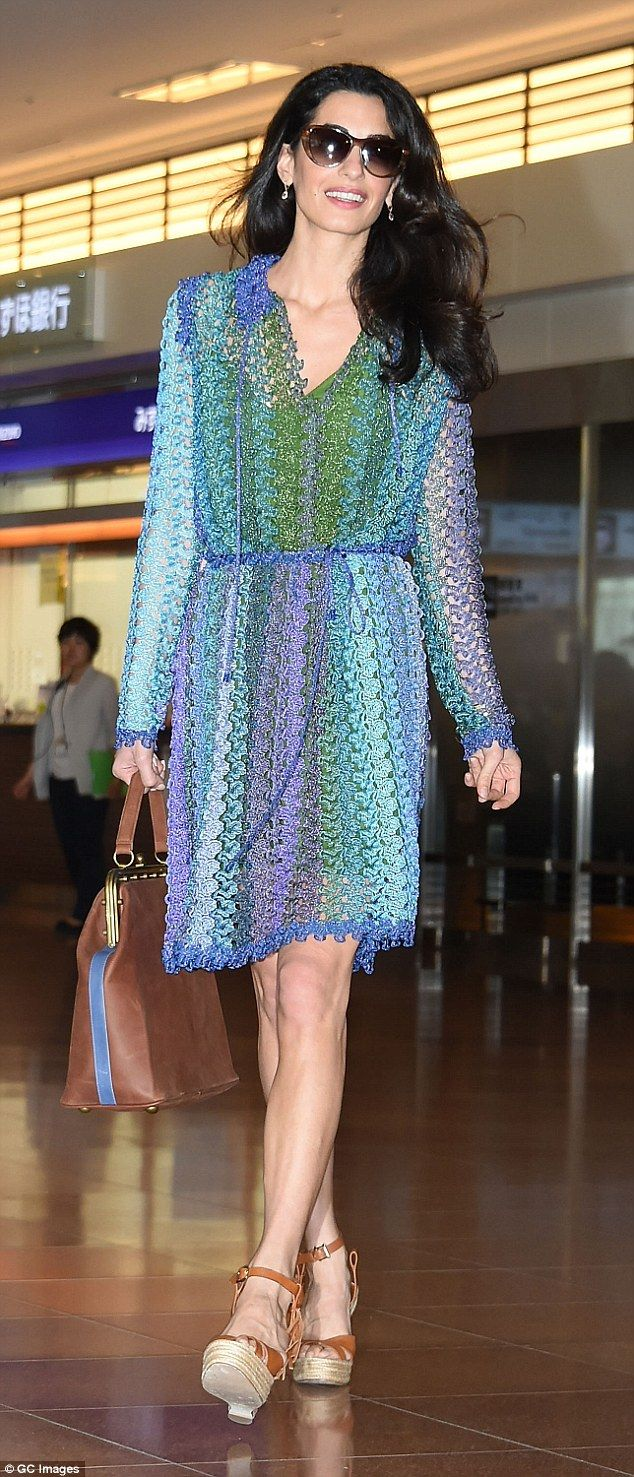 Stunning: Amal, 37, looked beautiful in an unusual blue, green and purple dress, which tied at the waist