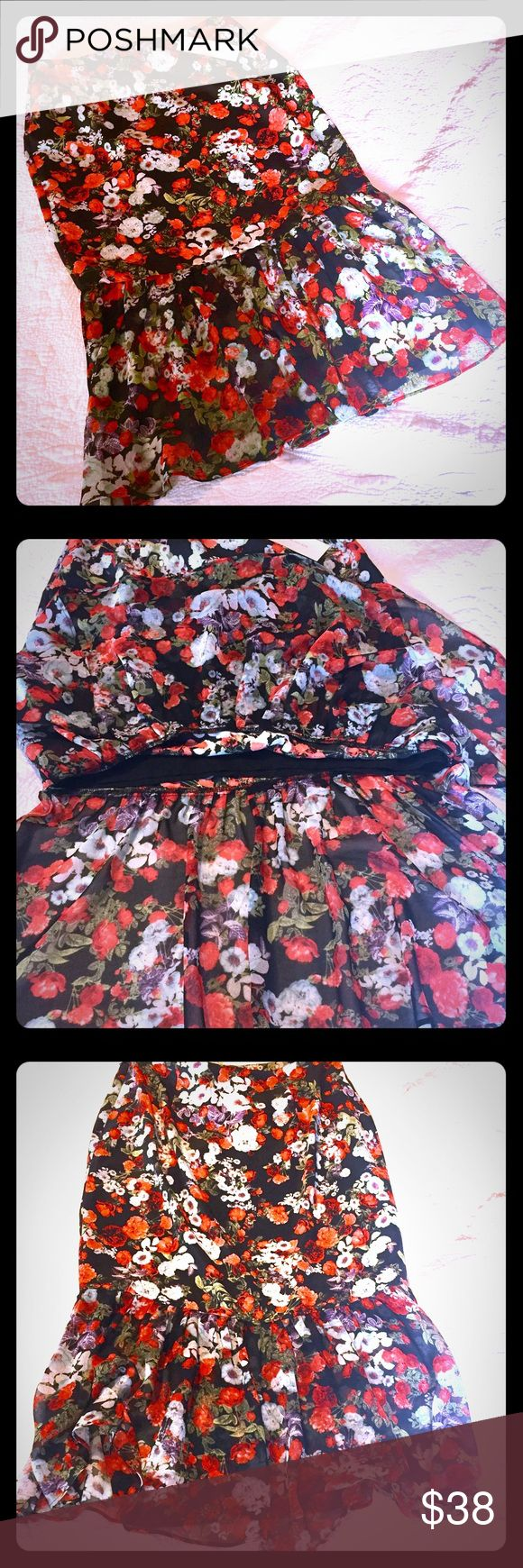 "BCBGeneration floral skirt A lovely skirt by BCBGeneration.  A flounced skirt featuring a fully lined mini skirt with a double side slit lower ruffle.  Side hidden zipper and hook enclosure Black background with red, light blue, and purple floral design. A beautifully soft 100% polyester texture that flows so elegantly. Size 4.  Length measures 29"": waist measures 29"" that sits at hips. BCBGeneration Skirts Midi"