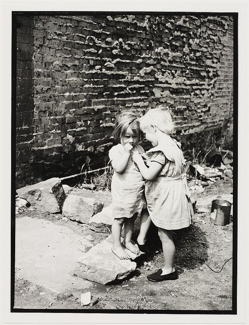 Children playing in the Sydney slums, mainly Surry Hills, Woolloomooloo, Redfern, 1949. Photo by Ted Hood,shared by State Library of New South Wales collection, via Flickr.  v2e.