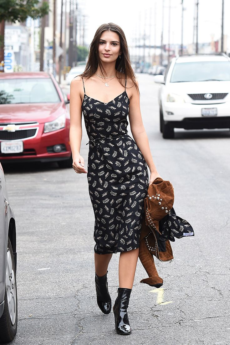 Emily Ratajkowski proving that a pair of patent ankle boots are all you need to bring your slip dress into autumn/winter