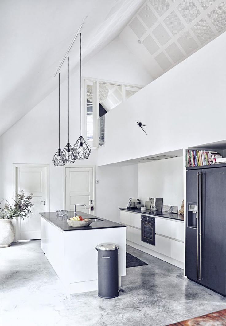 Lamp shades, counter, black fridge