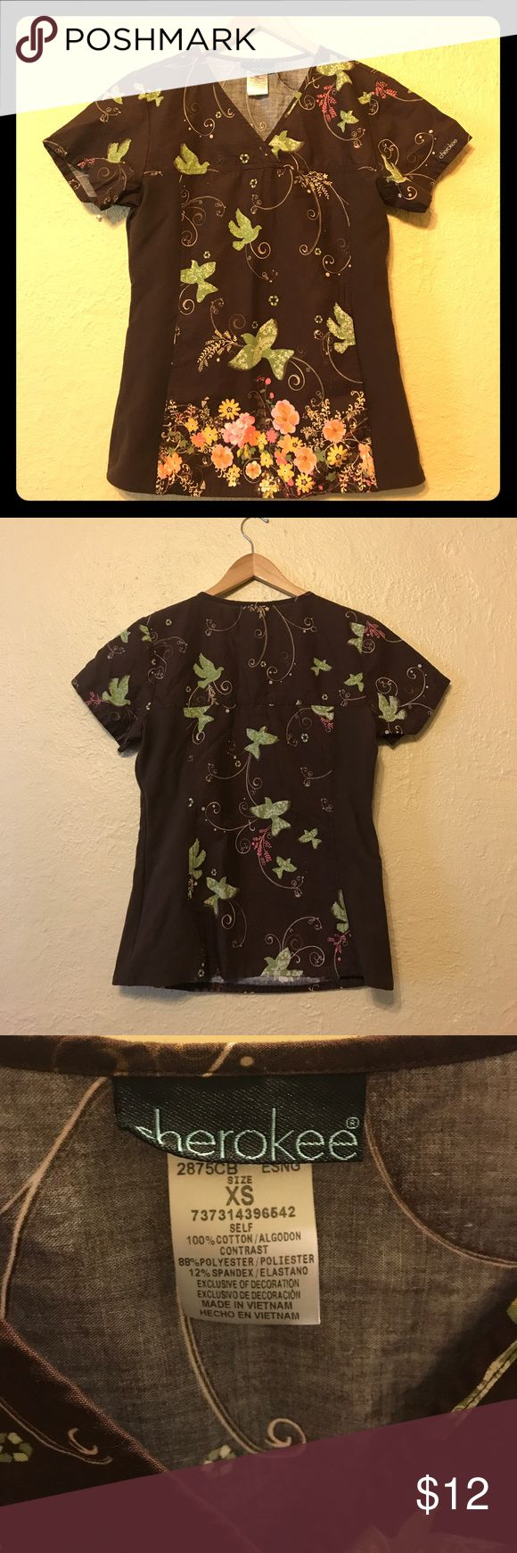 NWOT Whimsical Cherokee Scrub Top Scrub top by Cherokee. Brown with whimsical flowers and birds. Soft and stretchy side panels.  Never worn. I worked at a scrubs store for a few months, bought way too many, and never even wore most of them.  I have the pants to match this as well. I will give a discount if you buy both. Cherokee Tops