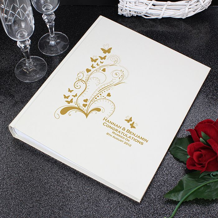 This Gold Butterfly Swirl Traditional Album can be personalised with any message of your choice over 4 lines up to 25 characters per line. The first two lines are in bold.   The album has approximately 30 tissue interleaf pages.  Ideal for Weddings, Engagement gifts, Anniversary presents, Valentine's Day.  Please note due to the font type used on this item all characters will appear in uppercase.