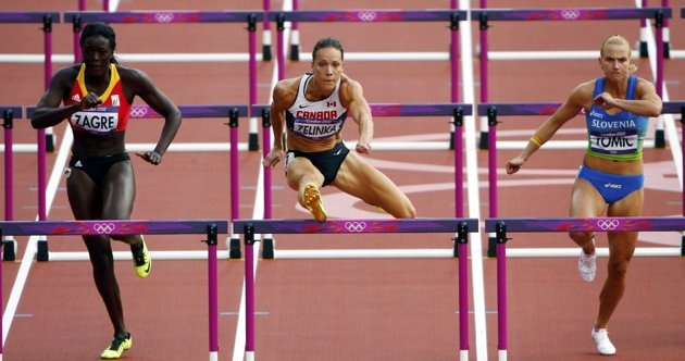 Canada's Jessica Zelinka (C) competes against Belgium's Anne Zagre (L) and Slovenia's Marina Tomic during their women's 100m hurdles round 1 heat in the London 2012 Olympic Games at the Olympic Stadium August 6, 2012.