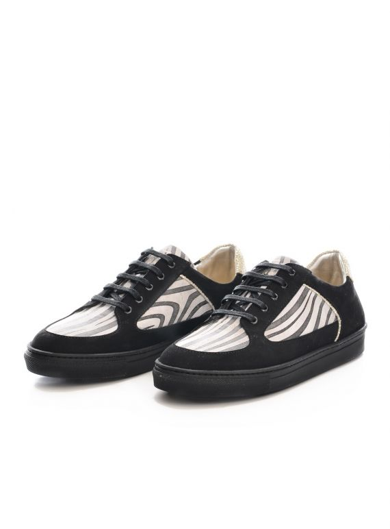 Rose Rankin is the name to know in British made luxe trainers. These zebra patterned lovelies are perfect for off duty and even on-duty wear.