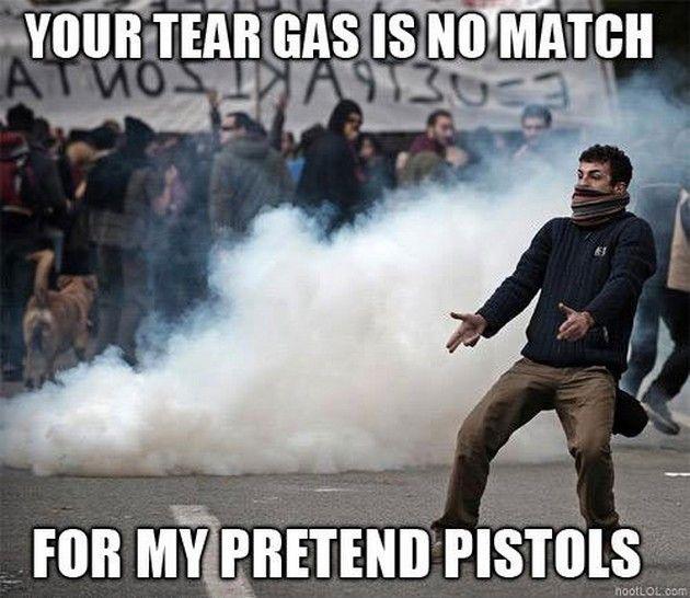 Funny Protestor Tear Gas Pretend Pistols Meme