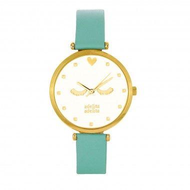 Reloj dorado mujer dorado con el fondo frambuesa. Para que mires la hora con otro color. Descubre más modelos en la web www.adelitaadelita.com