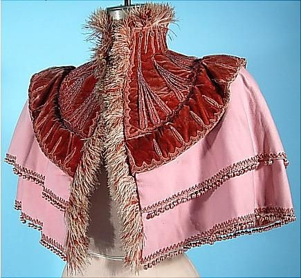 Emile Pingat, two-tone beaded dusty rose wool and silk velvet mantelette with striped balls and feather fringe, c. 1893 #cape #feathers #Pingat #Victorian