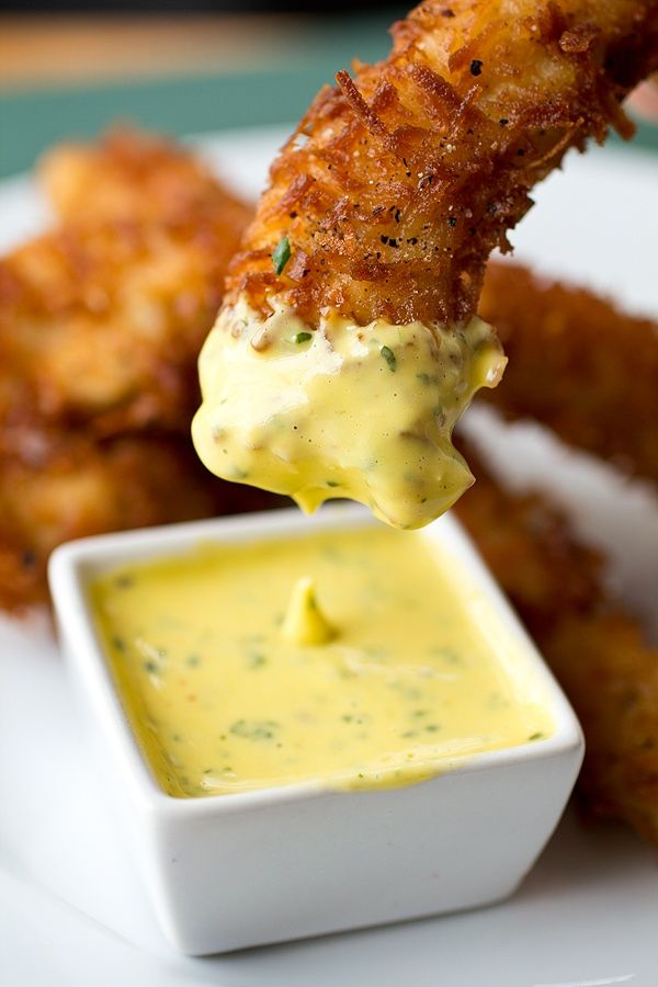 Coconut Crunch Chicken Strips with Creamy Honey-Mango Dipping Sauce - I think honey mustard would go good with this... but I guess that's just a personal preference. lol