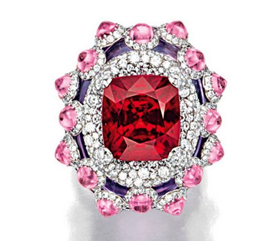 RED SPINEL, PINK SAPPHIRE, AMETHYST AND DIAMOND RING, WALLACE CHAN Centring on a cushion-shaped red spinel weighing 9.43 carats, to a stylised mount decorated with cabochon pink sapphires together weighing approximately 3.75 carats, supported by an oval amethyst, highlighted by brilliantcut diamonds extending to the shank, the diamonds together weighing approximately 5.05 carats, mounted in titanium, signed.