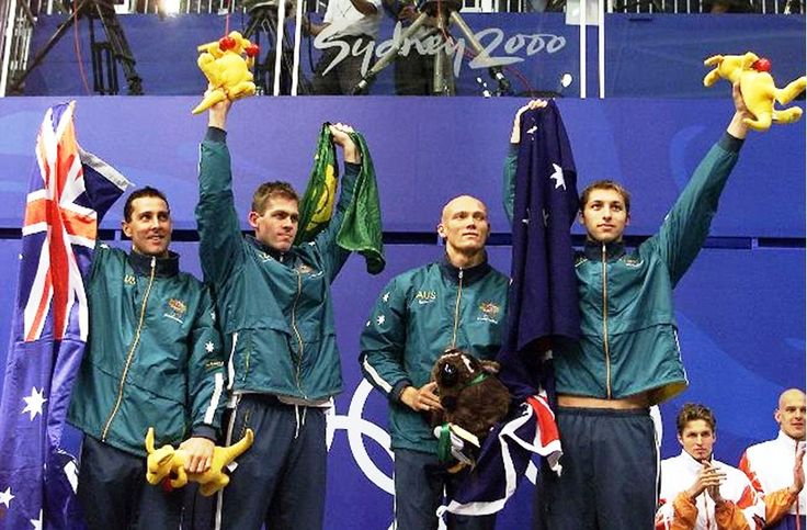Australian swimmers Bill Kirby, Todd Pearson, Michael Klim and Ian Thorpe wave to supporters at Homebush International Aquatic Centre after winning gold in 4x200 metre freestyle relay final. Picture: Gregg Porteous