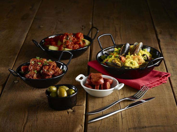 Superb Black Enamel Food Dishes. 14cm and 16cm Diameter available. Black really emphasises the colours in food and gives great table presentation. Available to buy-on-line from MK Limited http://www.mklimited.com/food-beverage-service/enamel-mugs-plates-bowls/black-enamel-paella-pans.html