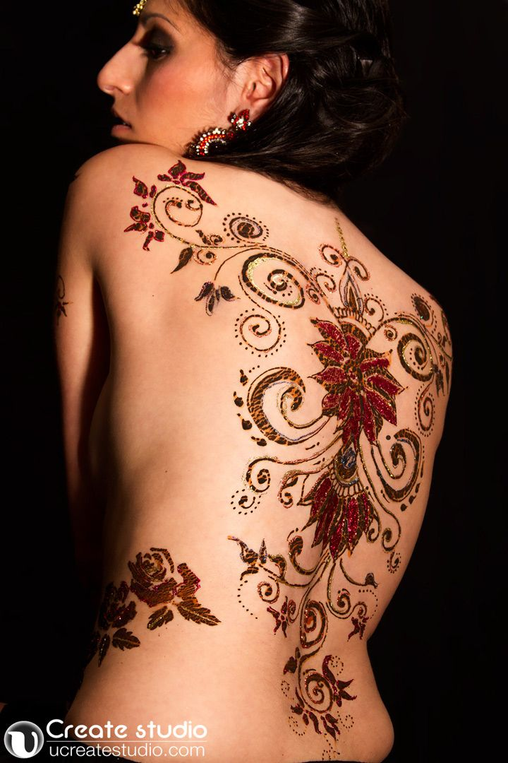 Henna body art in red and black