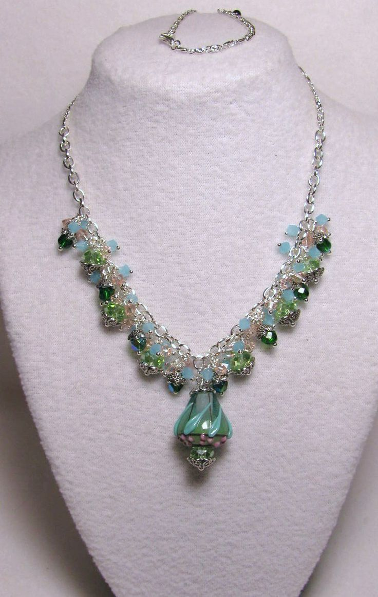 **SO MUCH PRETTIER IN PERSON***Item 1375 - JC Herrell Glass Baby Berry Bead (See Link to view price of just that bead alone & close-up; http://www.artbeads.com/bead-0783.html) Swarovski AB Emerald, Pink Tourmaline, Baby Blue Jade, Peridot Crystals, capped in Beauty $68 + $6 S&H.  Visit all my BEAUTIFUL jewelry pages, just follow the link: https://www.facebook.com/linda.foust.9?sk=photos...