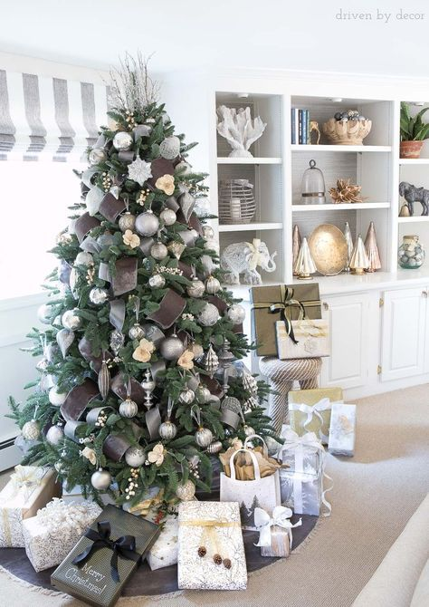 Love this Christmas tree! Decorated with wide gray velvet ribbon, silver ornaments, berries, and flowers!