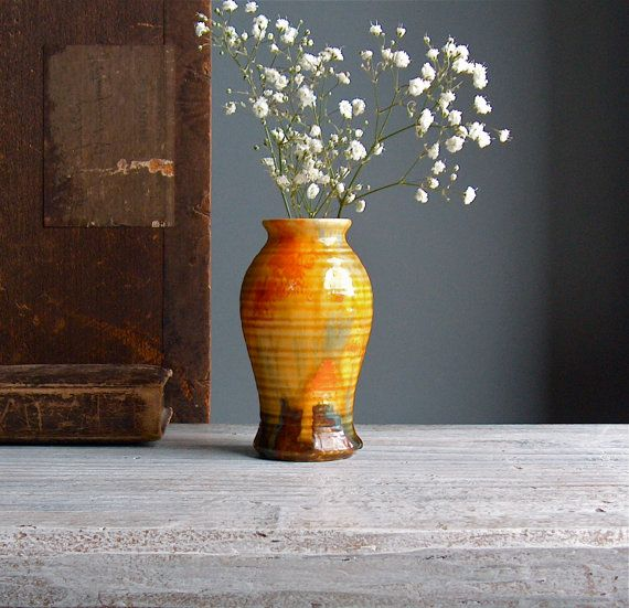 Drip glaze vase. Small ribbed posy vase in thick flowing glazes. 1940s. Vintage pottery vase in orange and reds.