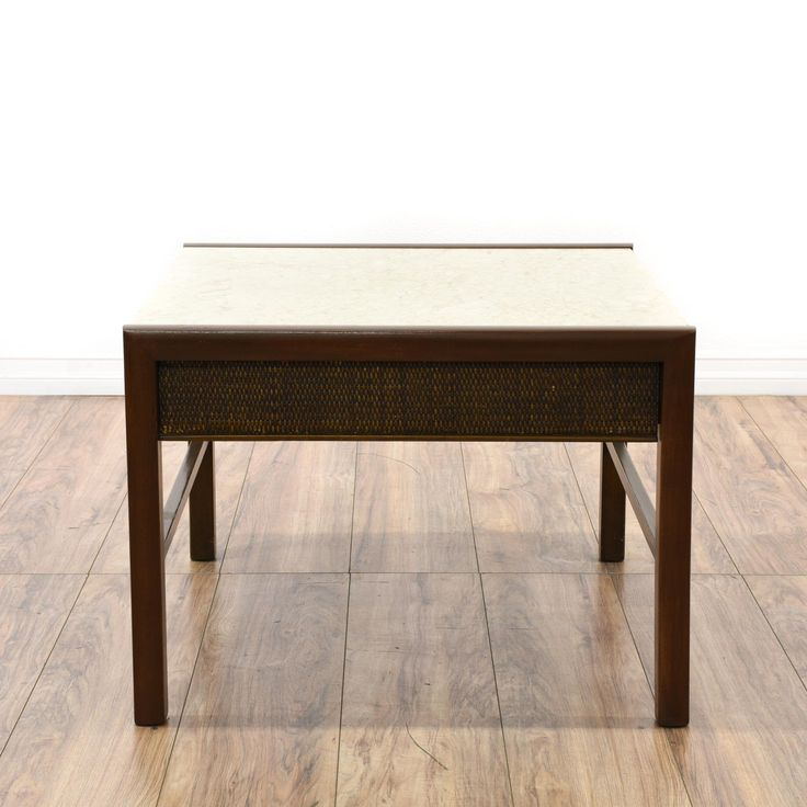 This contemporary end table is featured in a solid wood with a dark walnut finish. This side table has an off white marble table top with a woven front drawer and simple straight legs. Perfect as a small coffee table in a minimalist space! #contemporary #tables #endtable #sandiegovintage #vintagefurniture