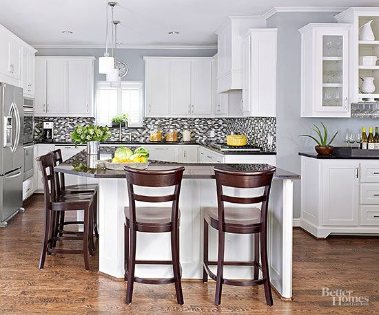 For a fresh twist on cottage style, coat your kitchen walls with pale blue paint. The soft, powdery shade showcases rich wood floors and sets off white-painted cabinetry, while being versatile enough to pair well with a variety of countertop and backsplash materials. Paint Color: Online SW7072, Sherwin-Williams./