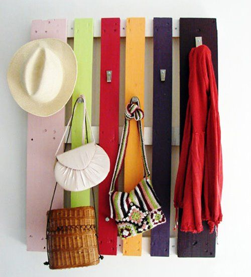 A little bit of paint, some hooks and a pallet. The perfect coat hanger!